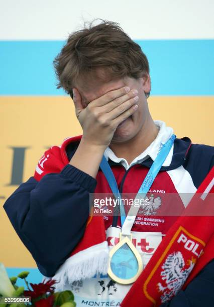 Otylia Jedrzejczak of Poland cries on the podium after receiving the gold medal and setting a new world record of 20561 in the 200 meter Butterfly...