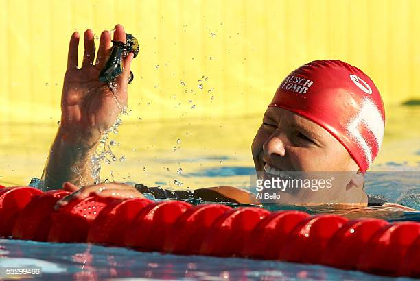 Otylia Jedrzejczak of Poland waves to the crowd after winning the gold medal and setting a new world record of 20561 in the 200 meter Butterfly final...