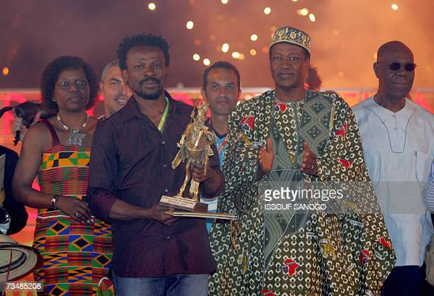 Burkina Fasoi Minister of Culture Arts and Tourism Aline Koala Nigerian director Newton Aduaka Burkina Faso President Blaise Compaore and musician of...