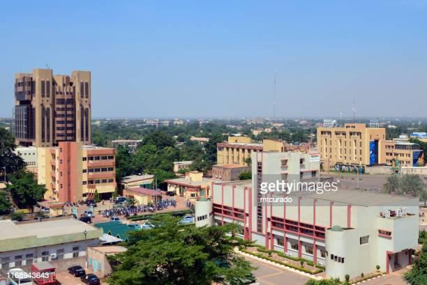 ouagadougou skyline - burkina faso - ouagadougou city center - skyline with the central bank of west african states (bceao) tower, the city hall, the social security and several other downtown government buildings - burkina faso - ouagadougou stock pictures, royalty-free photos & images