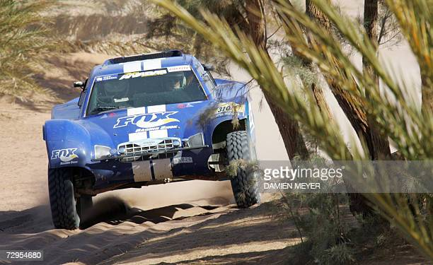 France's JeanLouis Schlesser in a Ford is on his way to win the fourth stage of the 29th Dakar between Er Rachidia and Ouarzazate09 January 2007...