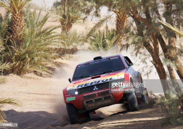 France's Luc Alphand steers his Mitsubishi during the fourth stage of the 29th Dakar between Er Rachidia and Ouarzazate 09 January 2007 JeanLouis...