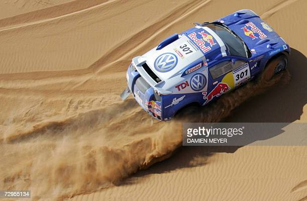 South Africa's Giniel De Villiers in a Volkswagen is pictured during the fourth stage of the 29th Dakar between Er Rachidia and Ouarzazate 09 January...