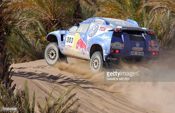 Spaniard Carlos Sainz in his Volkswagen on his way to take the second place behind JeanLouis Schlesser of France in a Ford during the fourth stage of...
