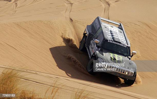 US Robby Gordon drives his Hummer during the fourth stage of the 29th Dakar between Er Rachidia and Ouarzazate 09 January 2007 JeanLouis Schlesser of...