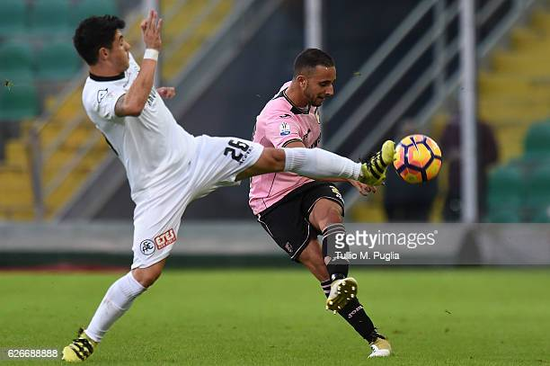 Ouasim Bouy of Palermo kicks the ball as Giuseppe Mastinu of Spezia tackles during the TIM Cup match between US Citta di Palermo and AC Spezia at...