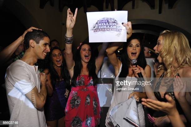 Ouassin Aouhal and Playboy Playmates attend the Official OnlineBootyCall Million Dollar Sweepstakes Party at Opera Crimson on June 20 2009 in Los...