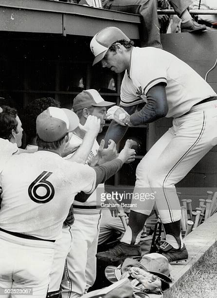 Ouch that hurts Blue Jays' designated hitter Sam Ewing grimaces in pain as he fouls a ball off his ankle in yesterday's exhibition game against...