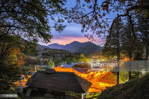 ouchijuku historical japanese village in autumn light up at sunset, aizuwakamatsu, fukushima japan - 東北地方 ストックフォトと画像