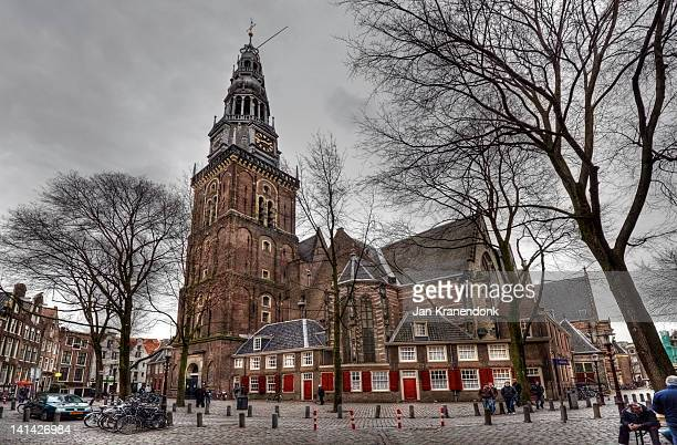Oude Kerk in the historic heart of Amsterdam Holland in cloudy winter weather