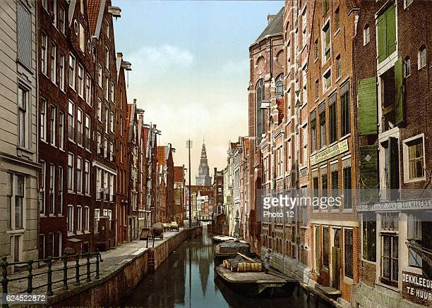 Oude Zyds, the Kolk, Amsterdam, Holland. View of canal in the old Jewish quarter, with flat-bottomed punts or barges on the water.