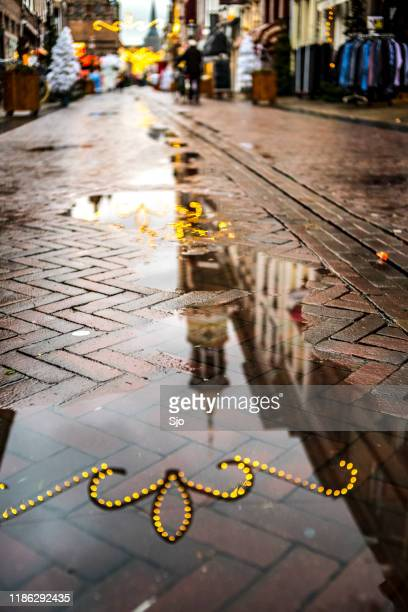 oudestraat shopping street with people shopping in the city of kampen during a rainy day - overijssel stock pictures, royalty-free photos & images