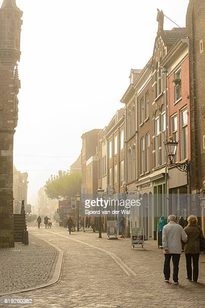 "oudestraat with people shopping in the city of kampen - ""sjoerd van der wal"" stockfoto's en -beelden"