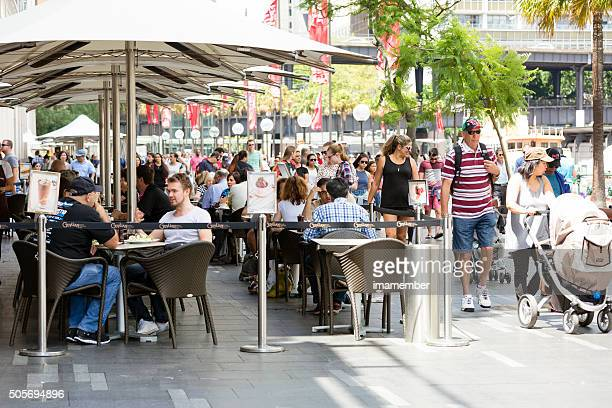 Oudoor restaurant on busy street with crowd of people, Sydney