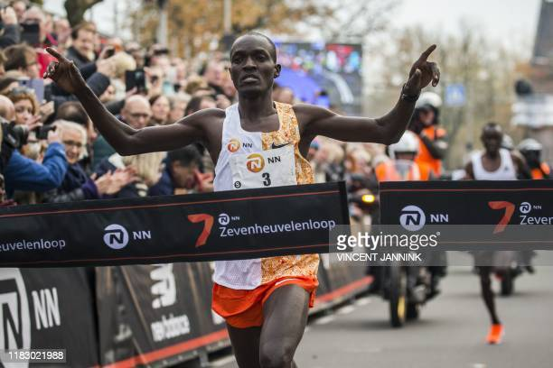Ouganda's athlete Stephen Kissa crosses the finish line to win the 36th edition of the 15kilometer long Zevenheuvelenloop in Nijmegen on November 17...