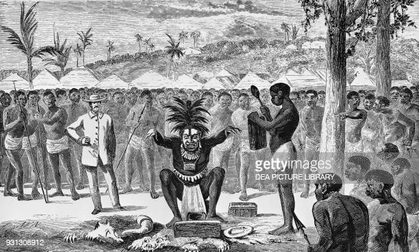 Ouganga performing an exorcism on a shaman, Central Africa, illustration from Voyages et aventures dans l'Afrique Equatoriale, by Paul Du Chaillu ,...