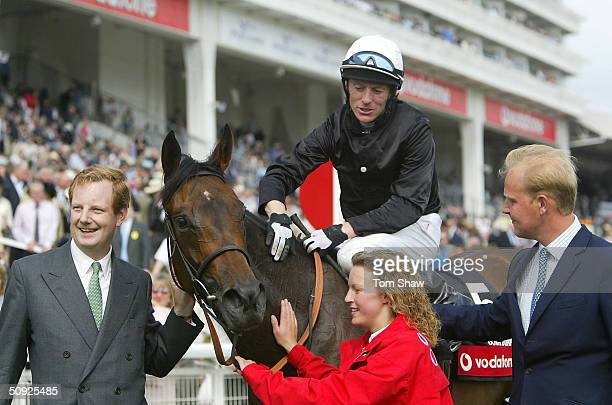 Ouija Board ridden by Kieran Fallon celebrates winning the Vodafone Oaks with owner Lord Derby and trainer Ed Dunlop at Epsom Racecourse June 4, 2004...