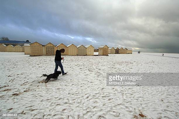 Ouistreham beach in Normandy is slightly covered by snow 27 December 2005 which is unusual for this area France upped weather alerts as cold weather...
