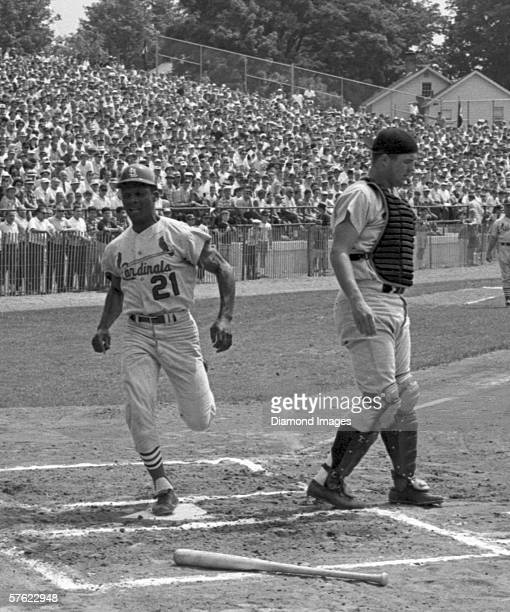 Ouitfielder Curt Flood of the St Louis Cardinals scores a run during the annual Hall of Fame game against the Minnesota Twins on July 25 1966 at...