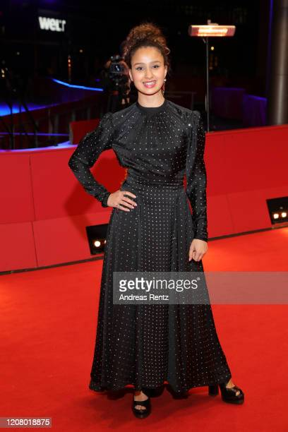 Oulaya Amamra poses at the The Salt of Tears premiere during the 70th Berlinale International Film Festival Berlin at Berlinale Palace on February 22...