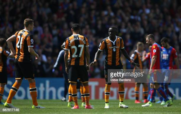 Oumar Niasse and Ahmed Elmohamady and Michael Dawson of Hull City in discussion during the Premier League match between Crystal Palace and Hull City...