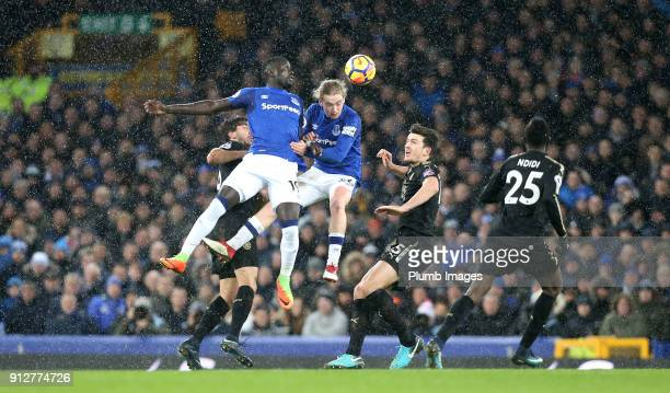 Oumar Niasse and Tom Davies of Everton in action with Harry Maguire and Aleksandar Dragovic of Leicester City during the Premier League match between...