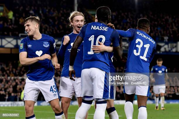Oumar Niasse celebrates his goal with Tom Davies and Jonjoe Kenny during the Carabao Cup Third Round match between Everton and Sunderland at Goodison...
