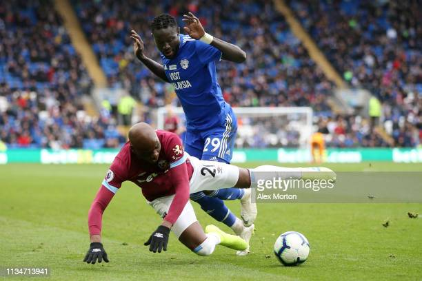 Oumar Niasse of Cardiff City battles for possession with Angelo Ogbonna of West Ham United during the Premier League match between Cardiff City and...