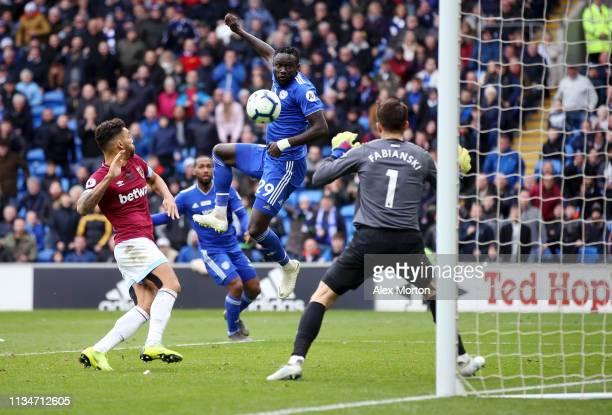 Oumar Niasse of Cardiff City heads on goal during the Premier League match between Cardiff City and West Ham United at Cardiff City Stadium on March...