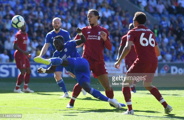 Oumar Niasse of Cardiff City shoots under pressure from Virgil van Dijk of Liverpool during the Premier League match between Cardiff City and...