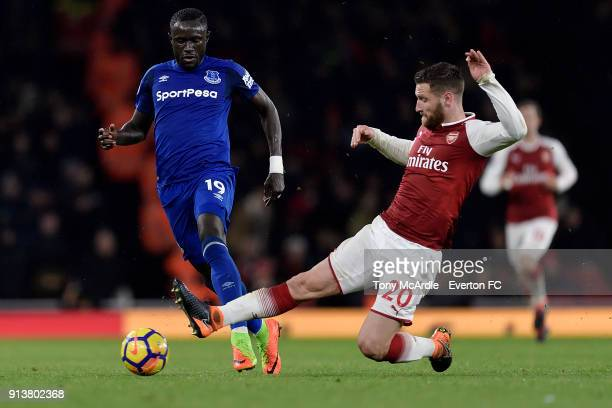 Oumar Niasse of Everton and Shkodran Mustafi during the Premier League match between Arsenal v Everton at Emirates Stadium on February 3 2018 in...