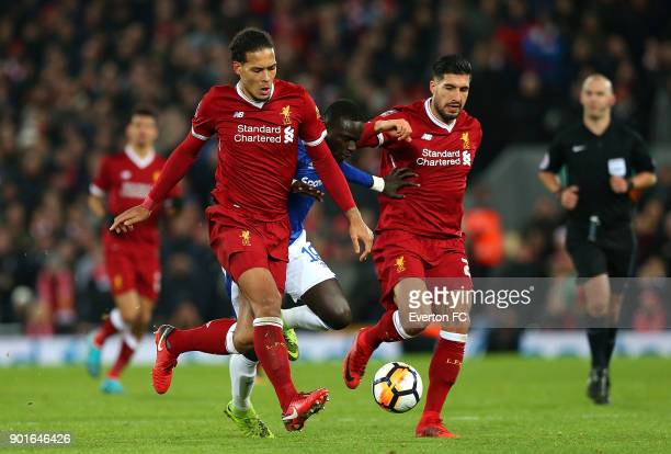 Oumar Niasse of Everton battles with Virgil van Dijk and Emre Can of Liverpool during the Emirates FA Cup third round match between Liverpool and...