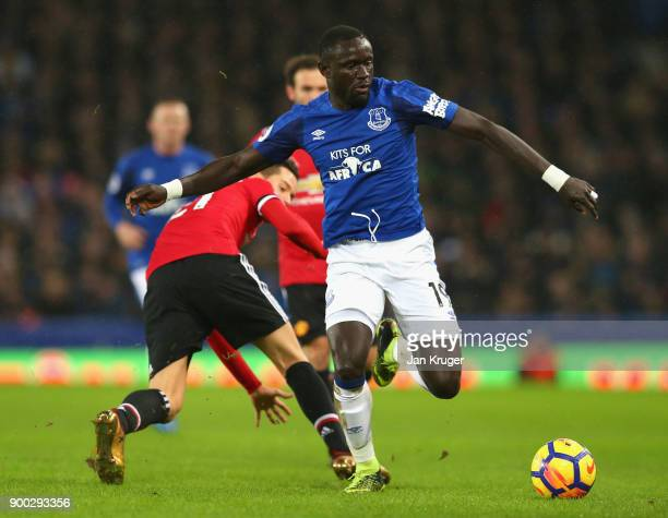 Oumar Niasse of Everton goes past Victor Lindelof of Manchester United during the Premier League match between Everton and Manchester United at...