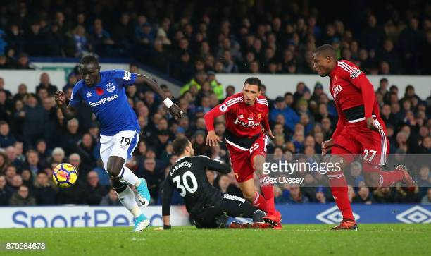 Oumar Niasse of Everton holds off Christian Kabasele of Watford as he goes on to score his sides first goal during the Premier League match between...