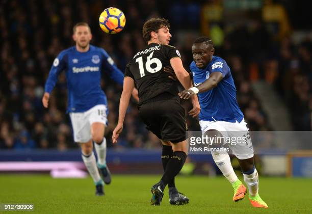 Oumar Niasse of Everton is challenged by Aleksander Dragovic of Leicester City during the Premier League match between Everton and Leicester City at...