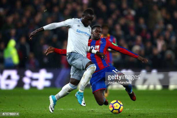 Oumar Niasse of Everton is tackled by Jeffrey Schlupp of Crystal Palace during the Premier League match between Crystal Palace and Everton at...