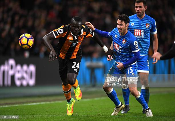 Oumar Niasse of Hull City and Adam Smith of AFC Bournemouth battle for possession during the Premier League match between Hull City and AFC...
