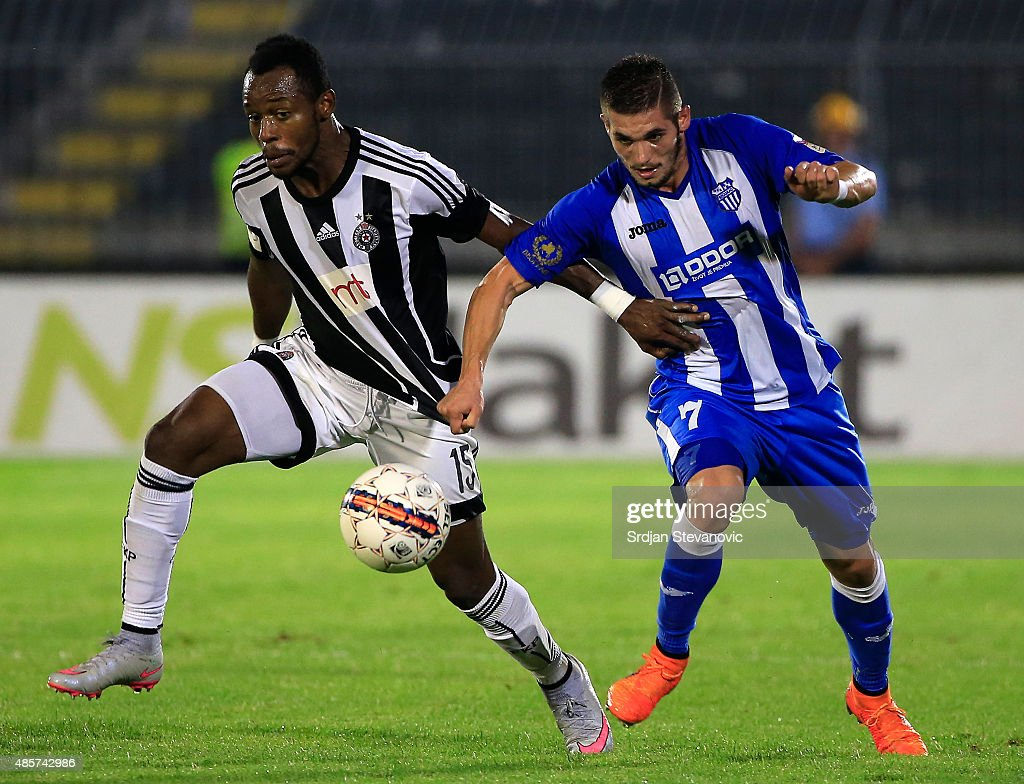 BELGRADE, SERBIA - AUGUST 29. Oumarou Aboubakar (L) of FK Partizan is challenged by Aleksandar Jesic (R) of OFK Belgrade during the Serbia Super League match between FK Partizan and OFK Belgrade at Partizan stadium in Belgrade, Serbia on Saturday, August 29, 2015.