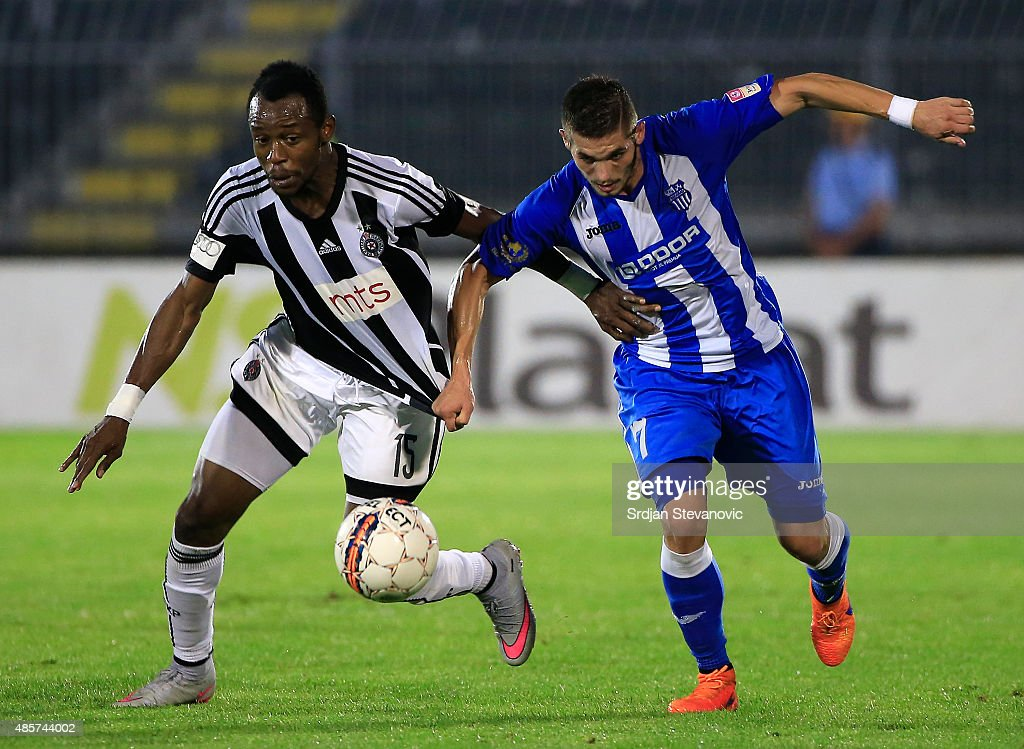 BELGRADE, SERBIA - AUGUST 29. Oumarou Aboubakar (L) of FK Partizan is challenged by Aleksandar Jesic (R) of OFK Belgrade during the Serbia Super League match between FK Partizan and OFK Belgrade at Partizan stadium August 29, 2015 in Belgrade, Serbia.