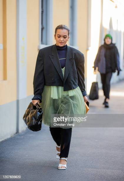 Oumayma El Boumeshouli is seen wearing sheer skirt black cropped blazer outside Tods during Milan Fashion Week Fall/Winter 20202021 on February 21...