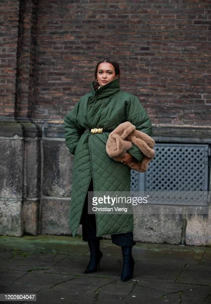 Oumayma Elboumeshouli is seen wearing green coat, brown teddy bag outside Lovechild on Day 1 during Copenhagen Fashion Week Autumn/Winter 2020 on...