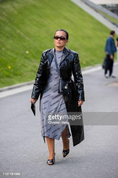 Oumayma Elboumeshouli is seen wearing grey Balenciaga dress, black coat outside Undercover during Paris Fashion Week - Menswear Spring/Summer 2020 on...