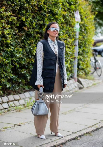 Oumayma Elboumeshouli seen wearing vest, Louis Vuitton button shirt outside Stine Goya during Copenhagen Fashion Week Spring/Summer 2020 on August...