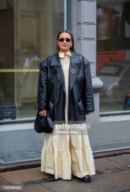 Oumayma Elboumeshouli wearing yellow dress, black leather jacket, black bag seen outside Gestuz on Day 1 during Copenhagen Fashion Week Autumn/Winter...