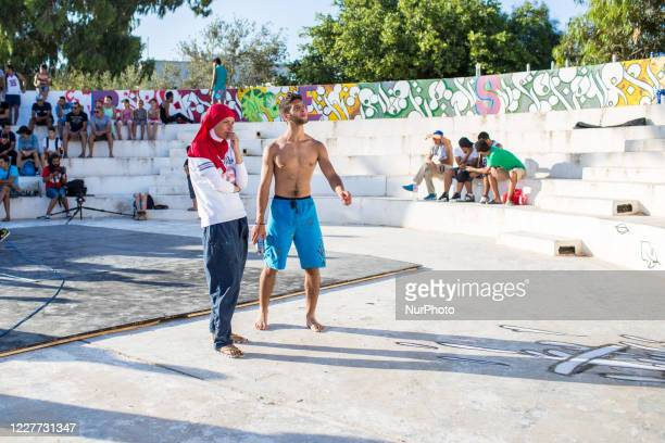 Oumema takes a step back from his work with another graffiti artist during a hip-hop festival in Hammamet, Tunisia, on August 8, 2016. This type of...