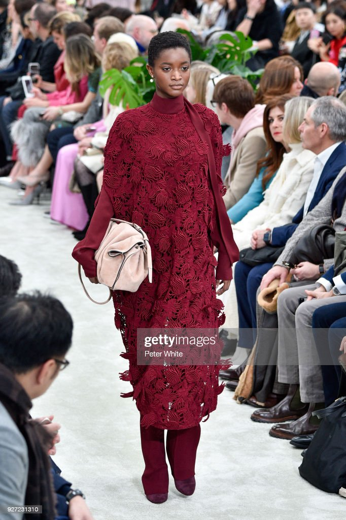 Oumie Jammeh walks the runway during the Valentino show as part of the Paris Fashion Week Womenswear Fall/Winter 2018/2019 on March 4, 2018 in Paris, France.