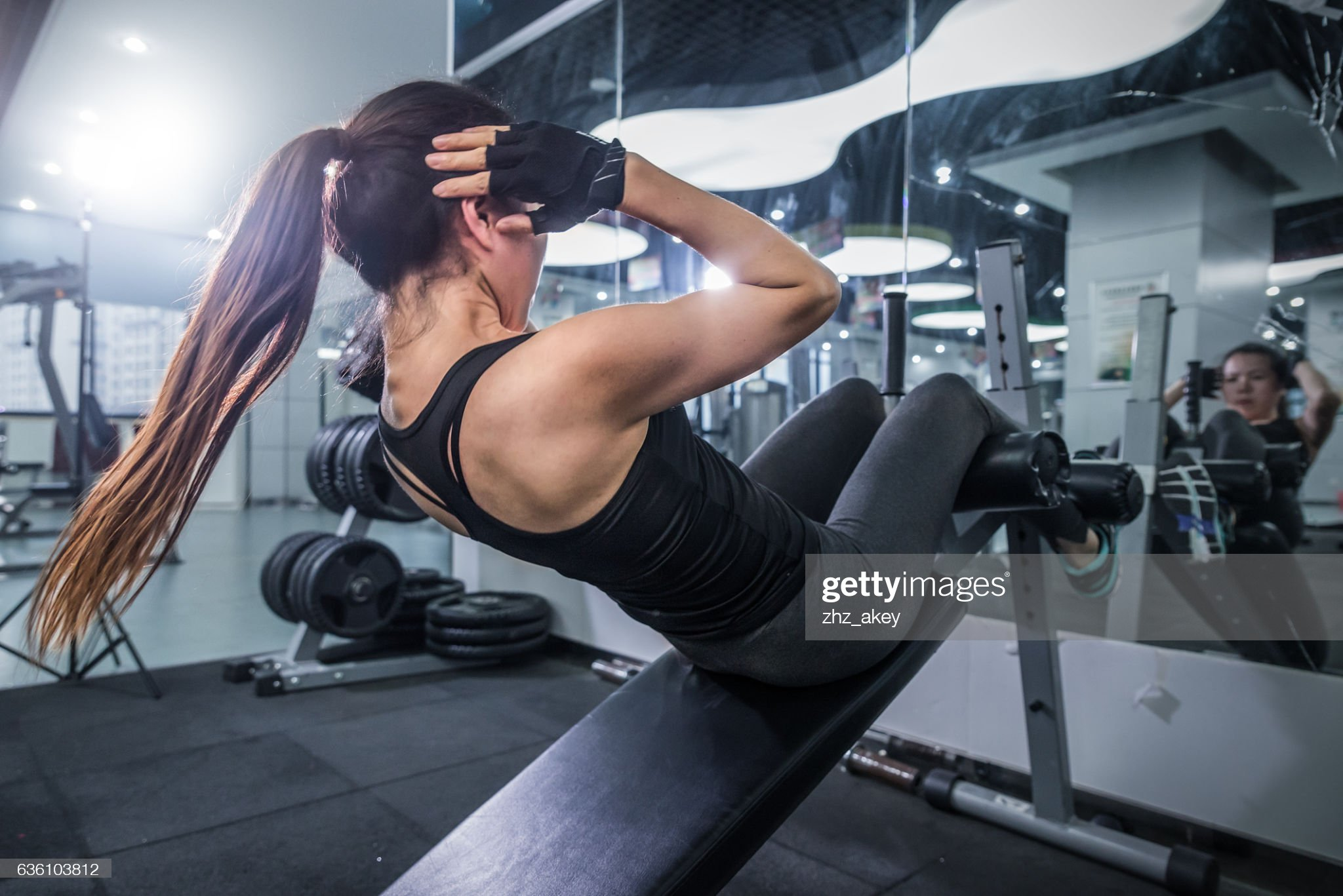 oung beautiful girl working out in modern gym : Stock Photo