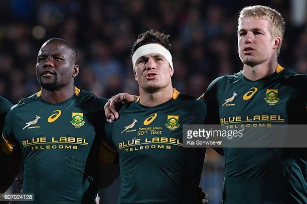 Oupa Mohoje Francois Louw and PieterSteph du Toit of the Springboks line up for their national anthem prior to the Rugby Championship match between...