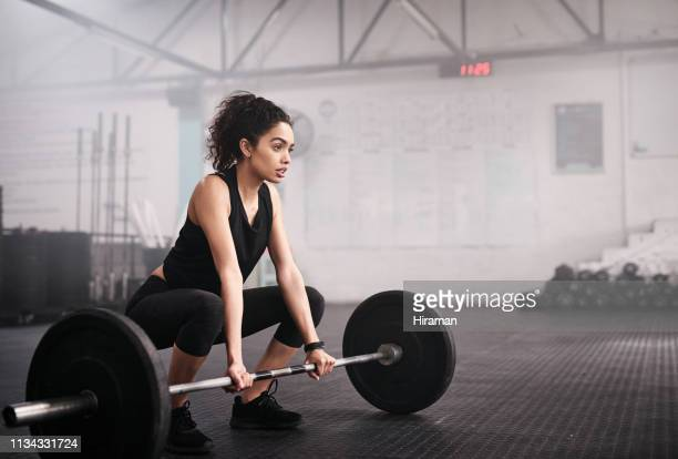 our bodies are capable of anything our minds believe - barbell stock pictures, royalty-free photos & images