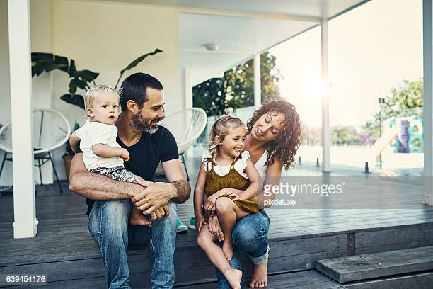 our children are our most precious possessions - family home stock photos and pictures
